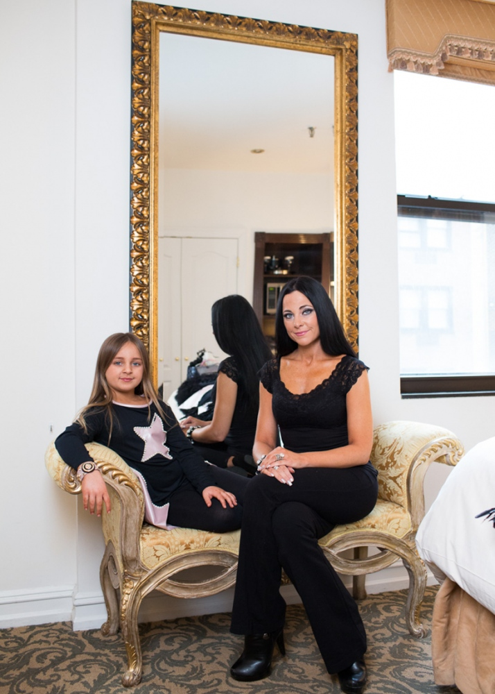 Former Toddler and Tiaras star Isabella Barrett, age 6, debuts her clothing line Bound by the Crown at New York Fashion Week. Pictured with mother Susanna For Nido Magazine