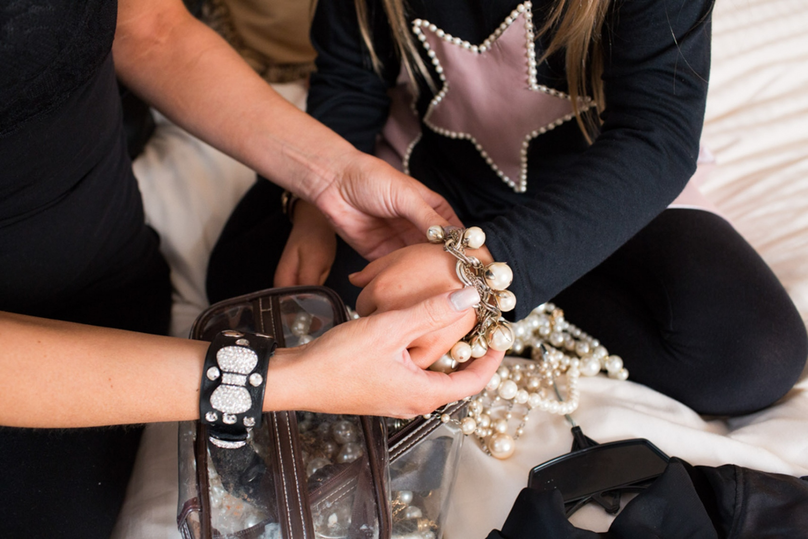 Isabella tries on accessories from her clothing line Bound by the Crown at New York Fashion Week For Nido Magazine