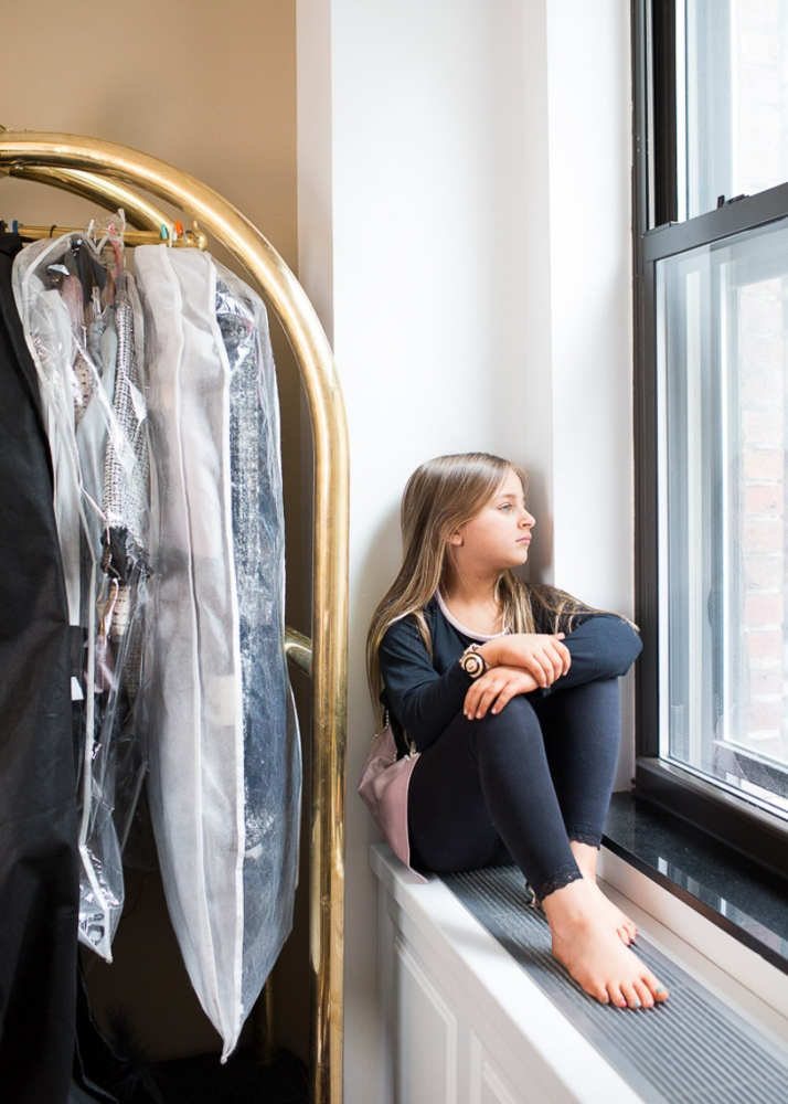 Former Toddler and Tiaras  star Isabella Barrett in her hotel room before the debut of her clothing line Bound by the Crown at New York Fashion Week ( for Nido Magazine)