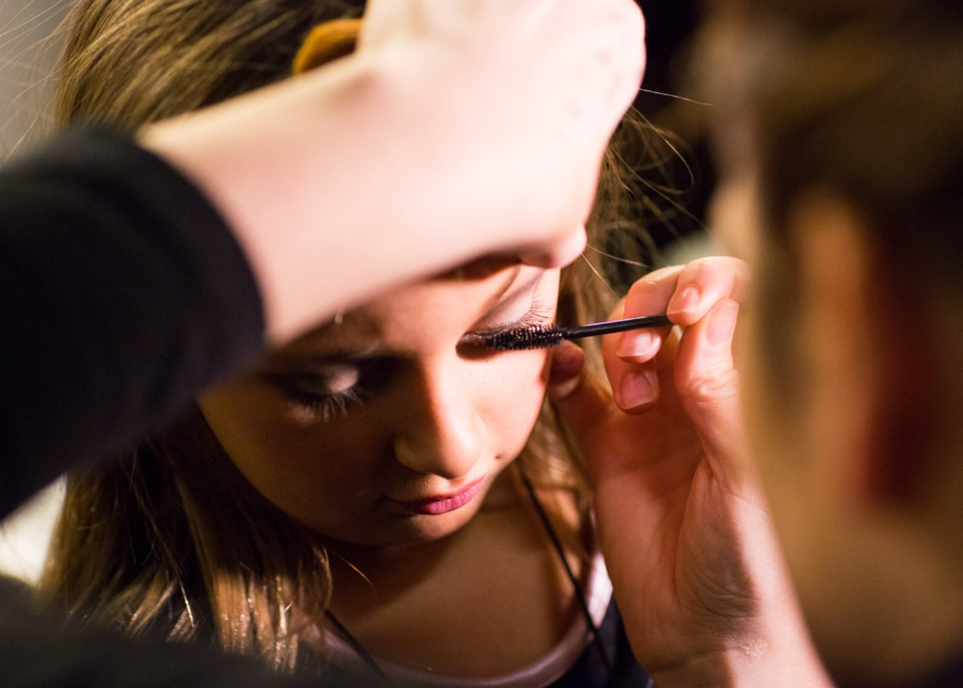 Isabella gets her makeup done backstage at New York Fashion Week For Nido Magazine