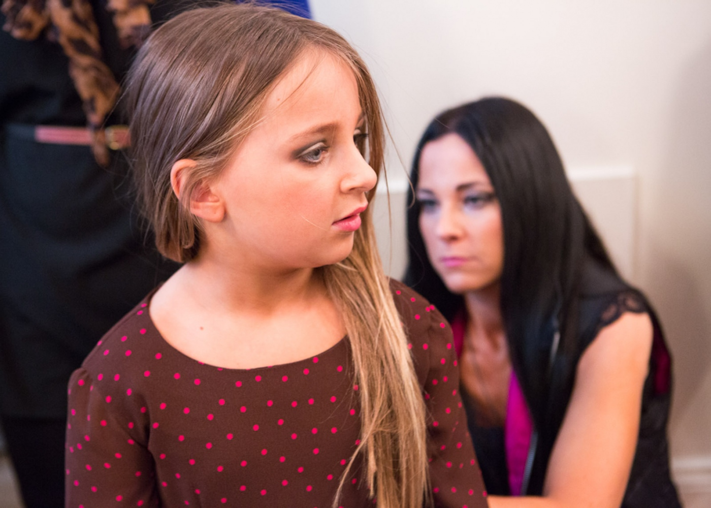 Isabella changes outfits backstage with the help of her mother Susanna at New York Fashion Week For Nido Magazine