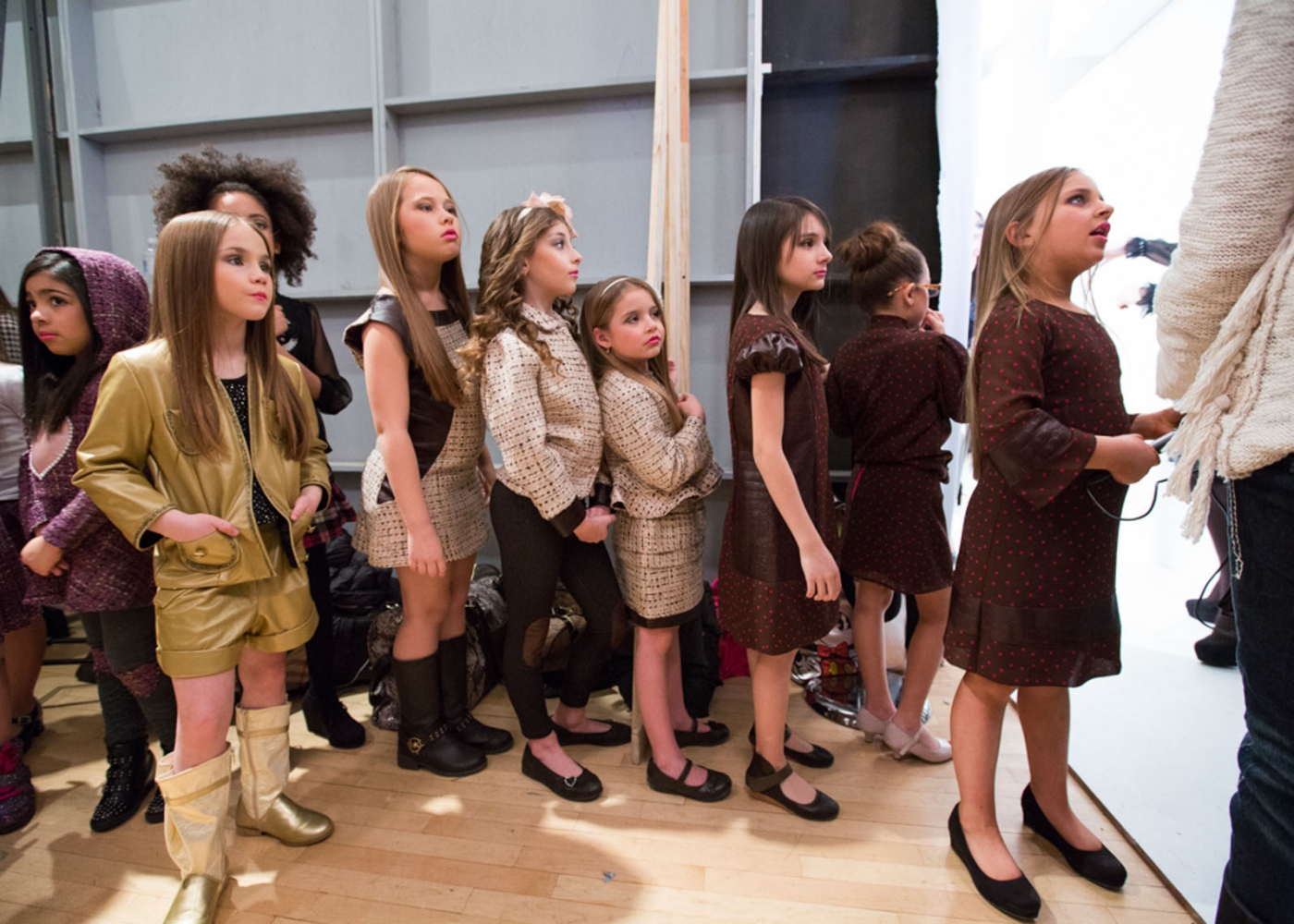 Isabella and fellow models wait backstage during the debut of her clothing line Bound by the Crown at New York Fashion Week For Nido Magazine