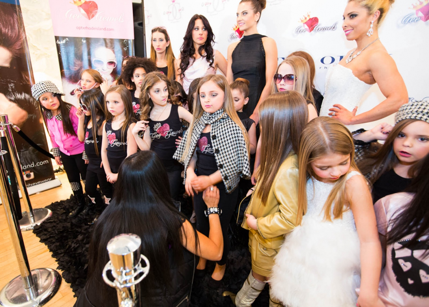 Isabella and models pose for a photo op after her clothing line debuts at New York Fashion Week For Nido Magazine