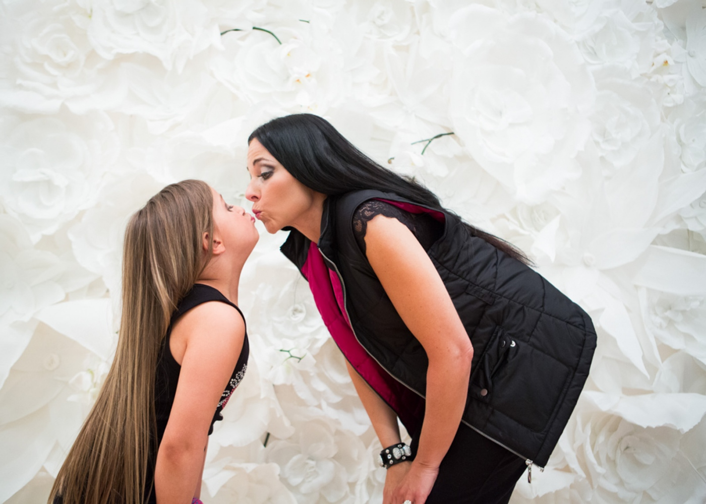 Isabella plants a kiss on her mother Susanna after the show at New York Fashion Week For Nido Magazine