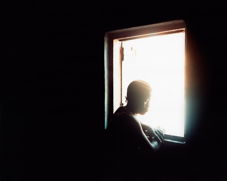 Fatmata in the window Freetown, Sierra Leone, 2006
