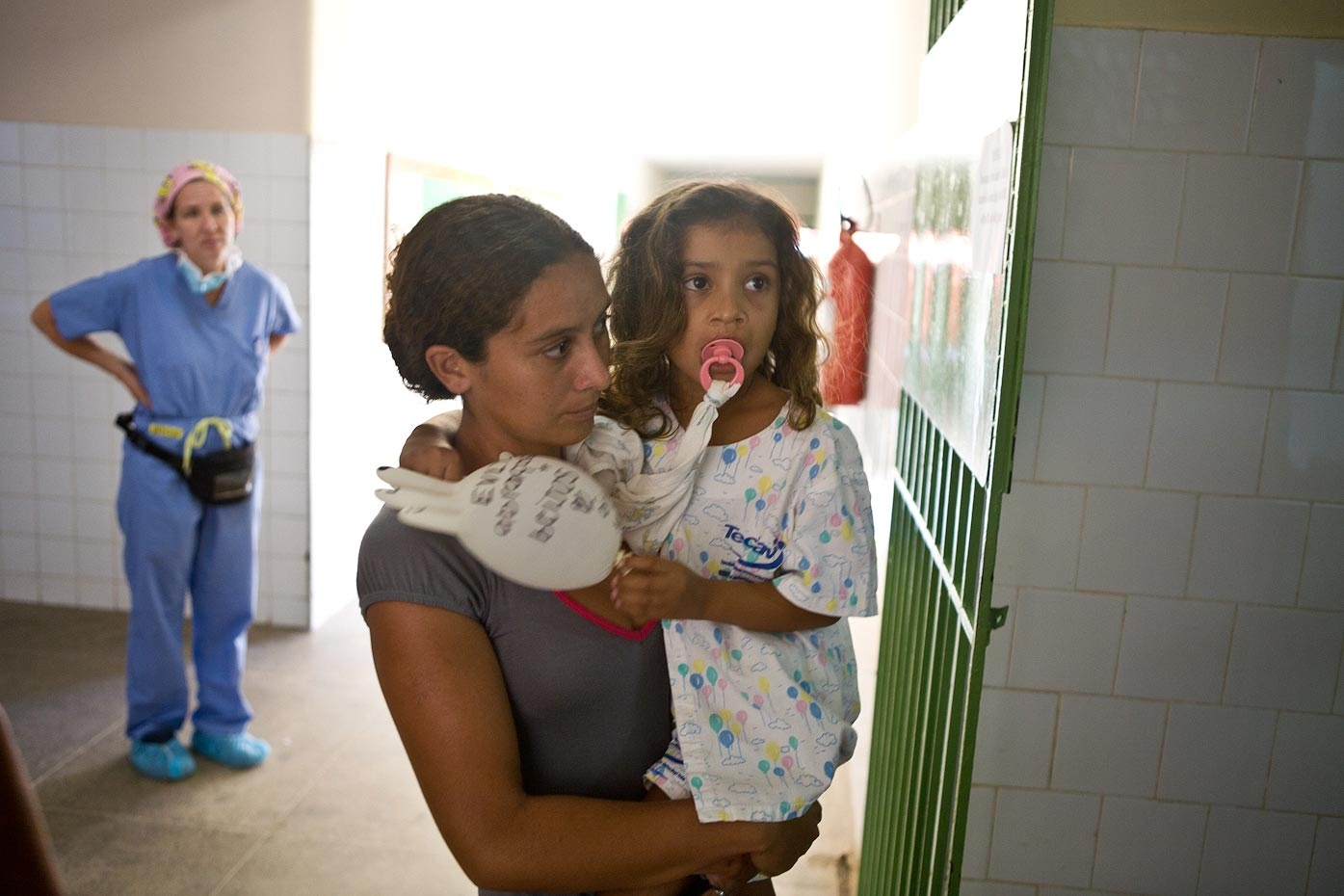 Evelyn and Luzirene walk into the operating room followed by Robin Birchenough, CRNA Aquiraz, Brazil, 2008 For Healing the Children Northeast