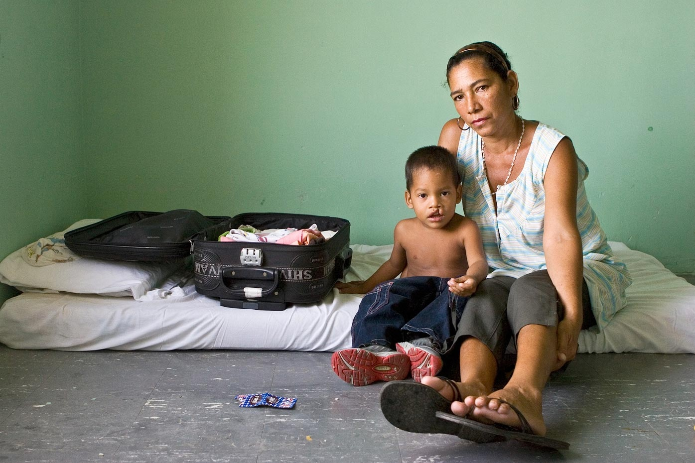 Cesar Comilo with his mother Santa Marta, Colombia, 2007 Some families travel for days to see the doctors. The hospital in Colombia allows them to stay for the whole week while they wait for their surgeries, providing mattresses to sleep on and 3 meals per day. For Healing the Children Northeast