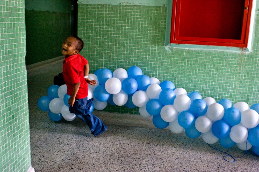 "Edwin with balloons Santa Marta, Colombia, 2007   ""The most rewarding aspect of the mission is knowing that a life is changed forever for the better. Knowing that suffering is alleviated. Knowing that a child can smile again; a smile he/she was deprived of because of the defect. These realities make my heart bigger and lighter. They make me smile too.""  -Elaine Suderio-Tirone, RN, Vassar Brothers Medical Center   For Healing the Children Northeast"