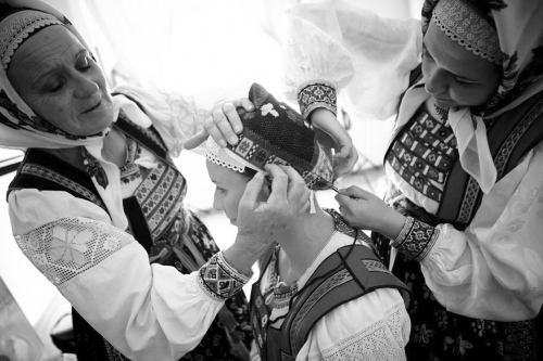 donning the headdress worn by married women