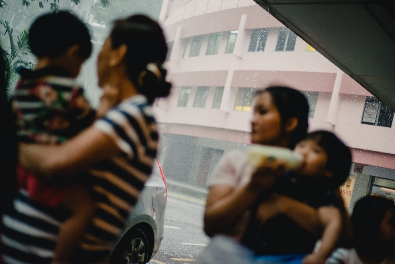 Foreign Domestic Workers with their wards outside a shopping centre in Singapore.