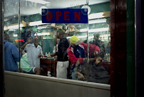 Barbershops are a social meeting place in Havana.