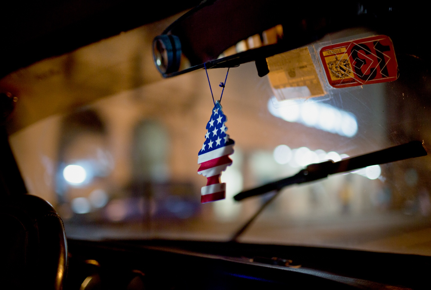 A taxi driver displays an air-freshener with the US flag on it. The Cubans are delighted at the relaxing of the political relations with the United States and generally have high hopes for their future.
