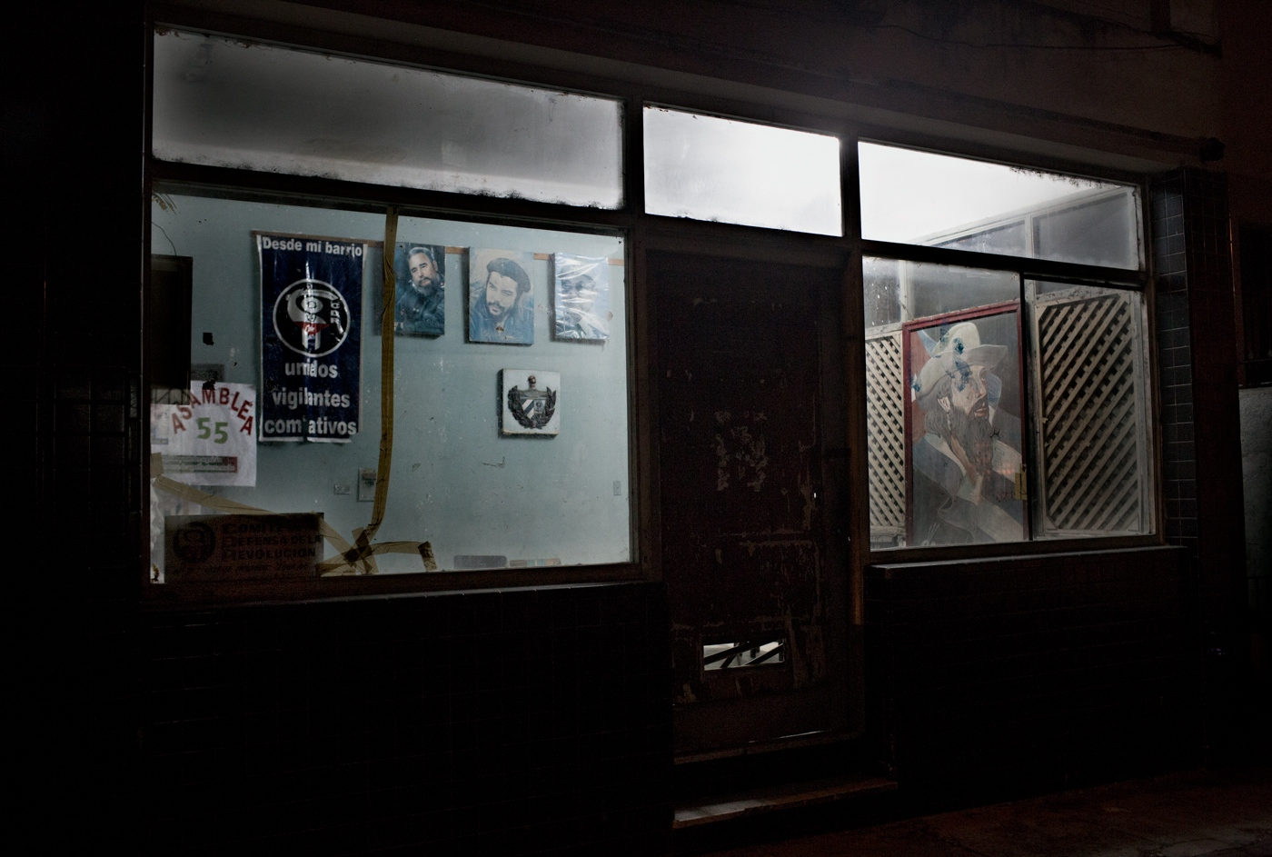 """A neighborhood watch office. The banner reads: """"From my neighborhood, United, Vigilante, Combative."""""""