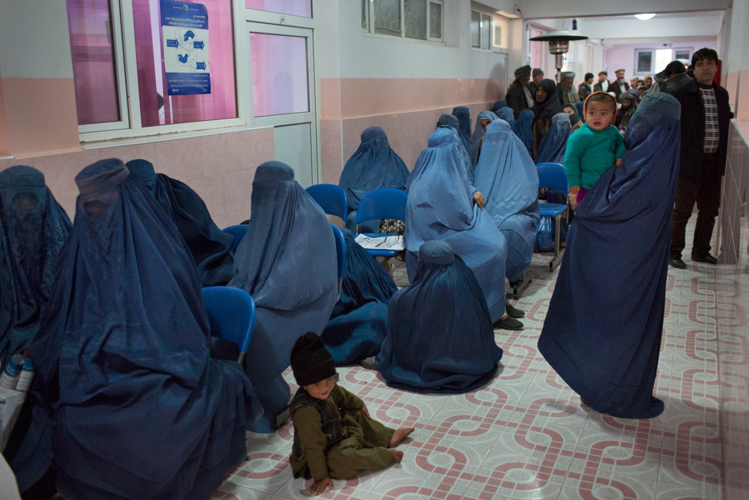 Waiting room for outpatients in Alemi's hospital. Doctor Alemi and his junior doctors see up to 120 patients a day, 6 days a week. Many travel long distances to be here, some as many as 700 kilometers. Mazar e Sharif, Afghanistan. December 2015.