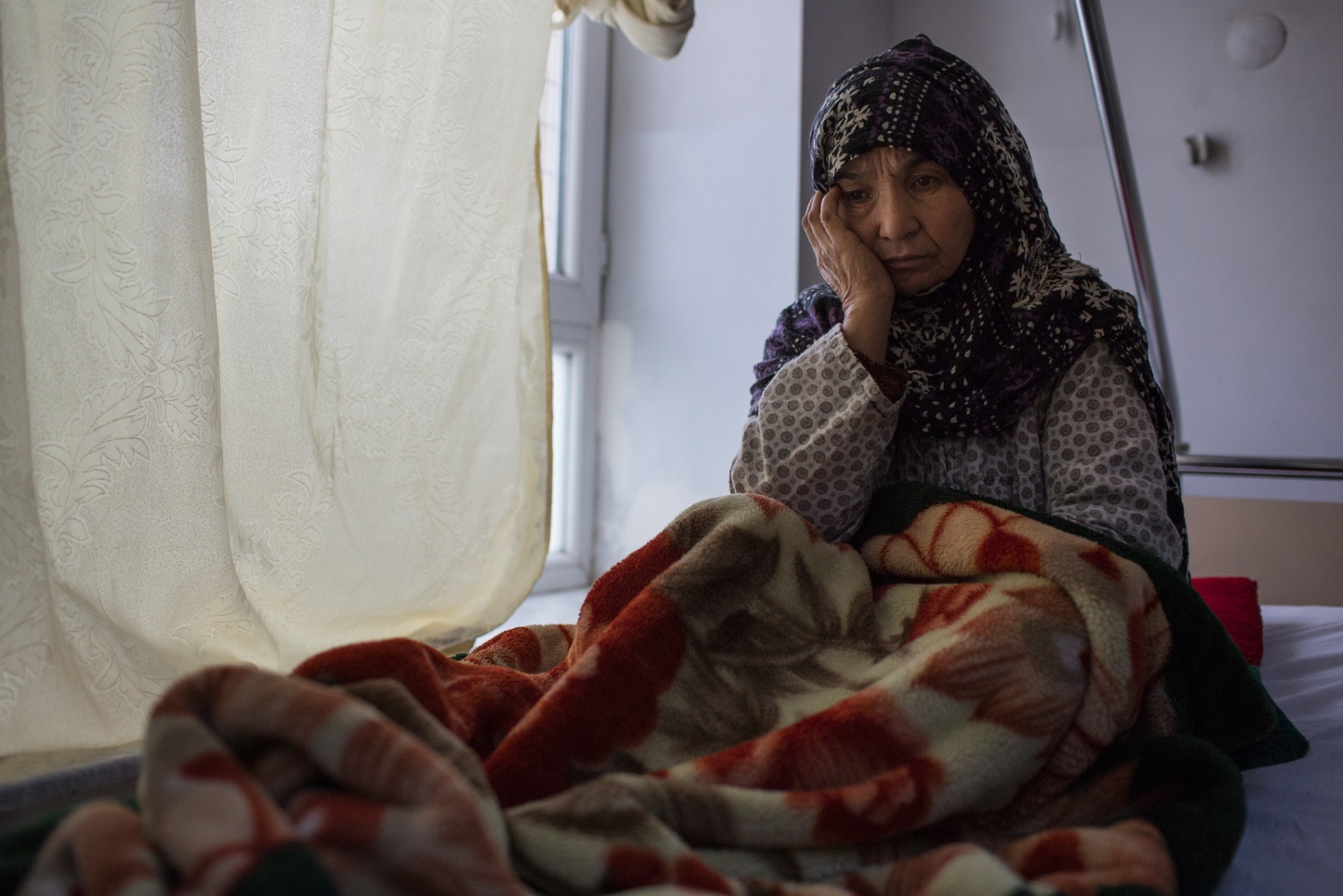 Her children brought Zahra to Mazar's public hospital after her depression got worse. They said she has taken medication for as long as they can remember. Zahra believes her problems began when she was very young when she was often scared at night whilst looking after cattle in the desert. Mazar e Sharif, Afghanistan. December 2015.