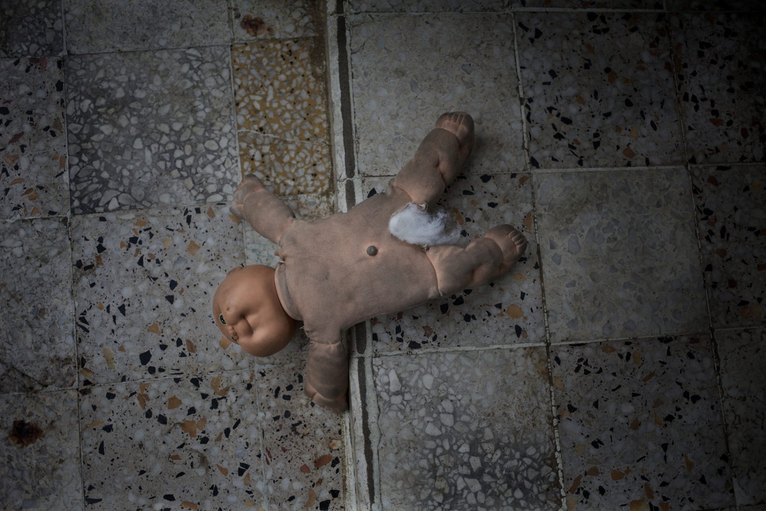 Monrovia, Liberia. July 2013. Doll left on the floor in a safe house for underage survivors of abuse and gender-based violence run by THINK Liberia. Sexual violence is a big problem and according to a recent Doctors Without Borders report, 92 percent of Liberia's rape victims seeking treatment are under the age of 18, an estimated 40 percent of which are under 12 years old. Ten percent are younger than five. It is not uncommon for students to be subject to sexual harassment.
