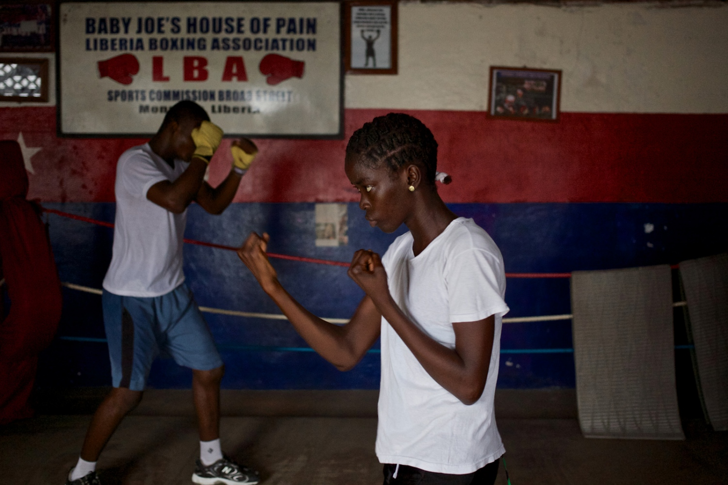 Monrovia, Liberia. July 2013 Hawa during boxing training. She is the only female attending boxing lessons at the local club.