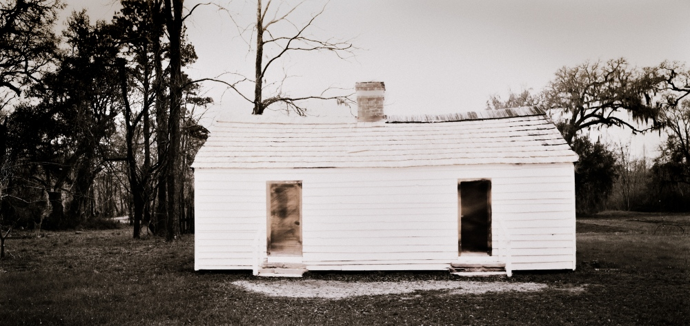 "Slave Dwelling 11, South Carolina silver gelatin contact print from 8x16"" film negative, transformed with bleach to express the ephemeral nature of these fragile structures"