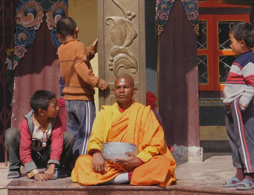 A mendicant monk at Boudinath Stupa.