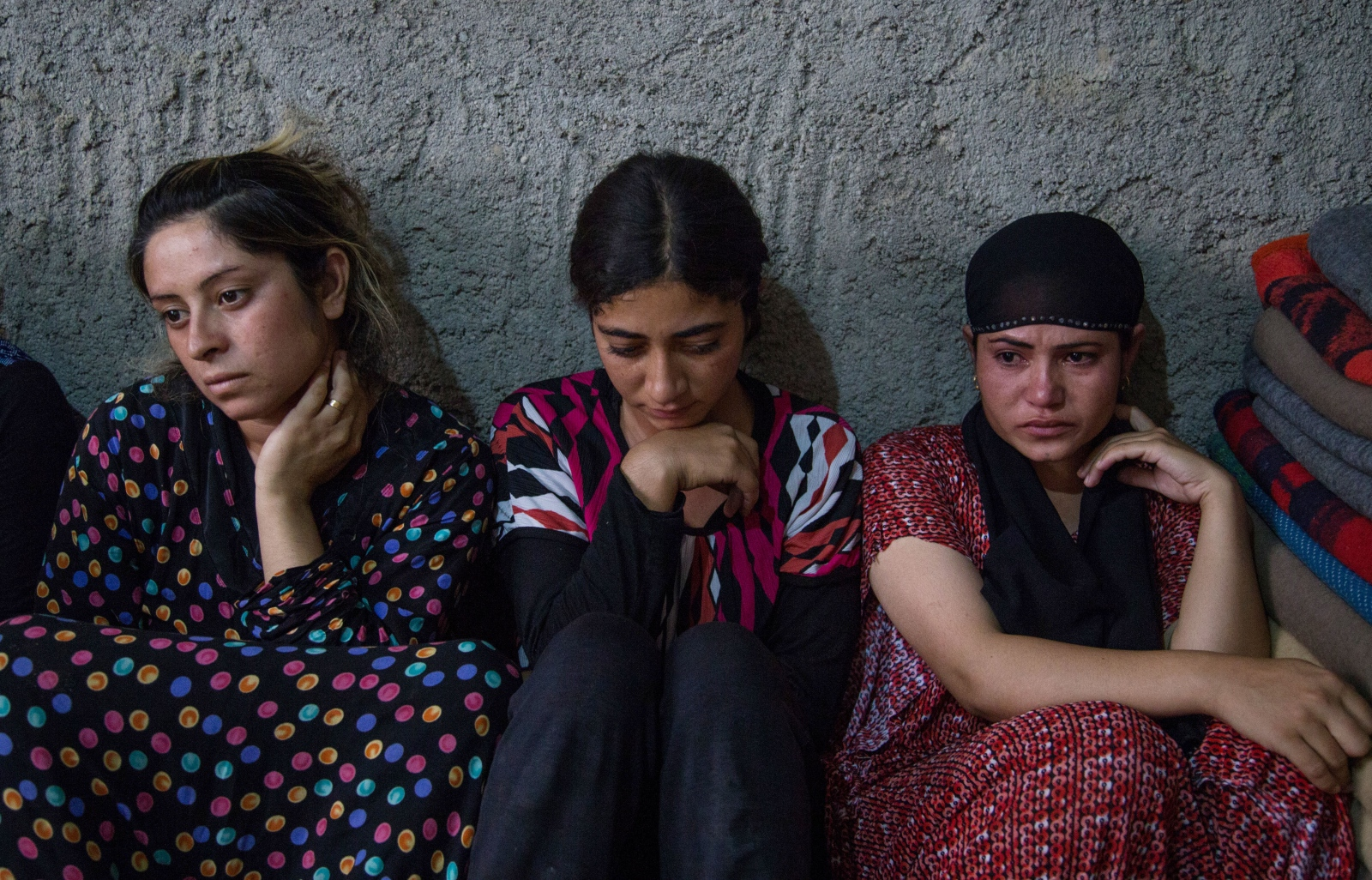 Yazidi girls take shelter in a construction site at Ba'Adre, Iraq after escaping ISIS militants in Mt. Sinjar.