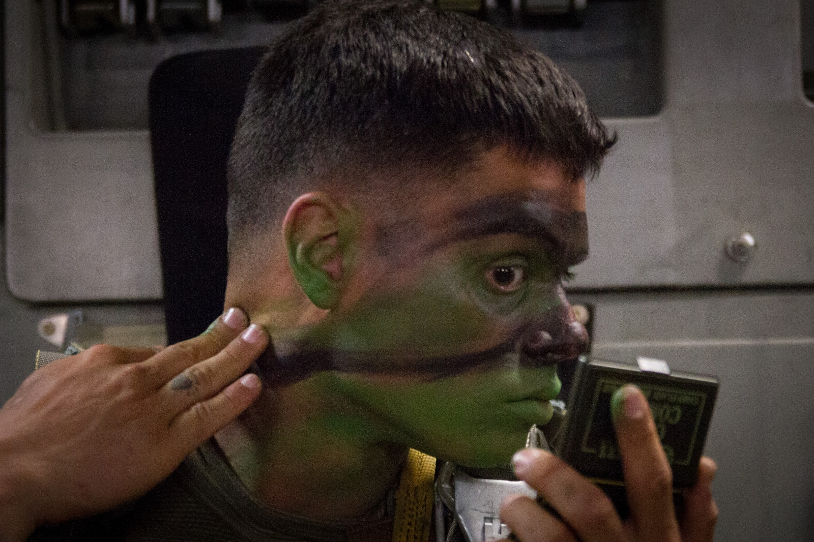 A paratrooper from the 82nd Airborne applied combat makeup prior to a training jump over Gabon Africa.