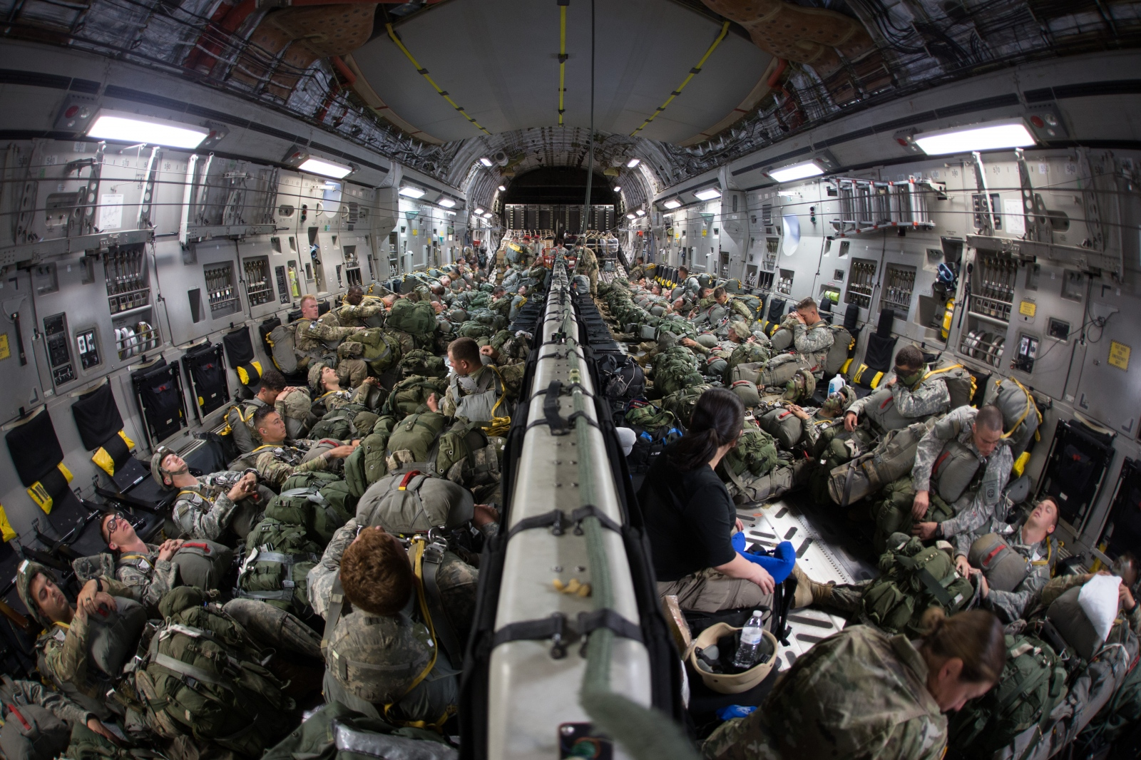 Paratroopers from the 82nd Airborne relax over the Atlantic while enroute to a training mission in Gabon Africa.
