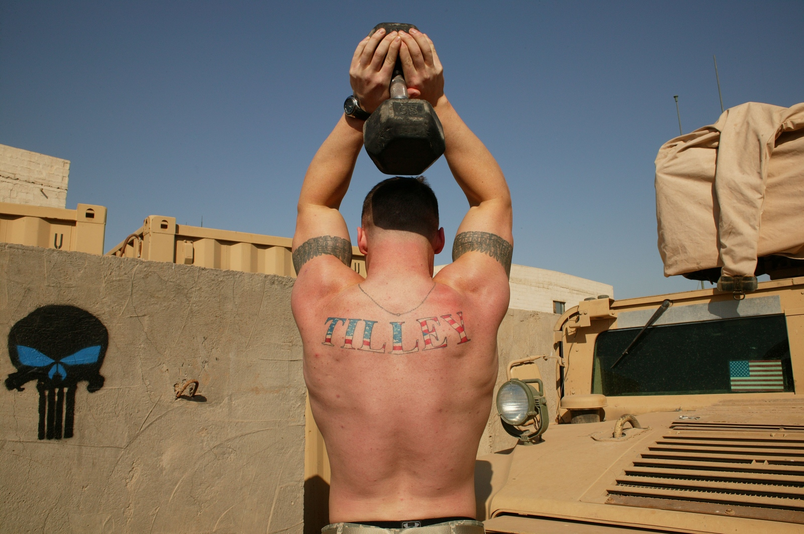 A U.S. soldier lifts weights at Forward Operating Base Falcon south of Baghdad.