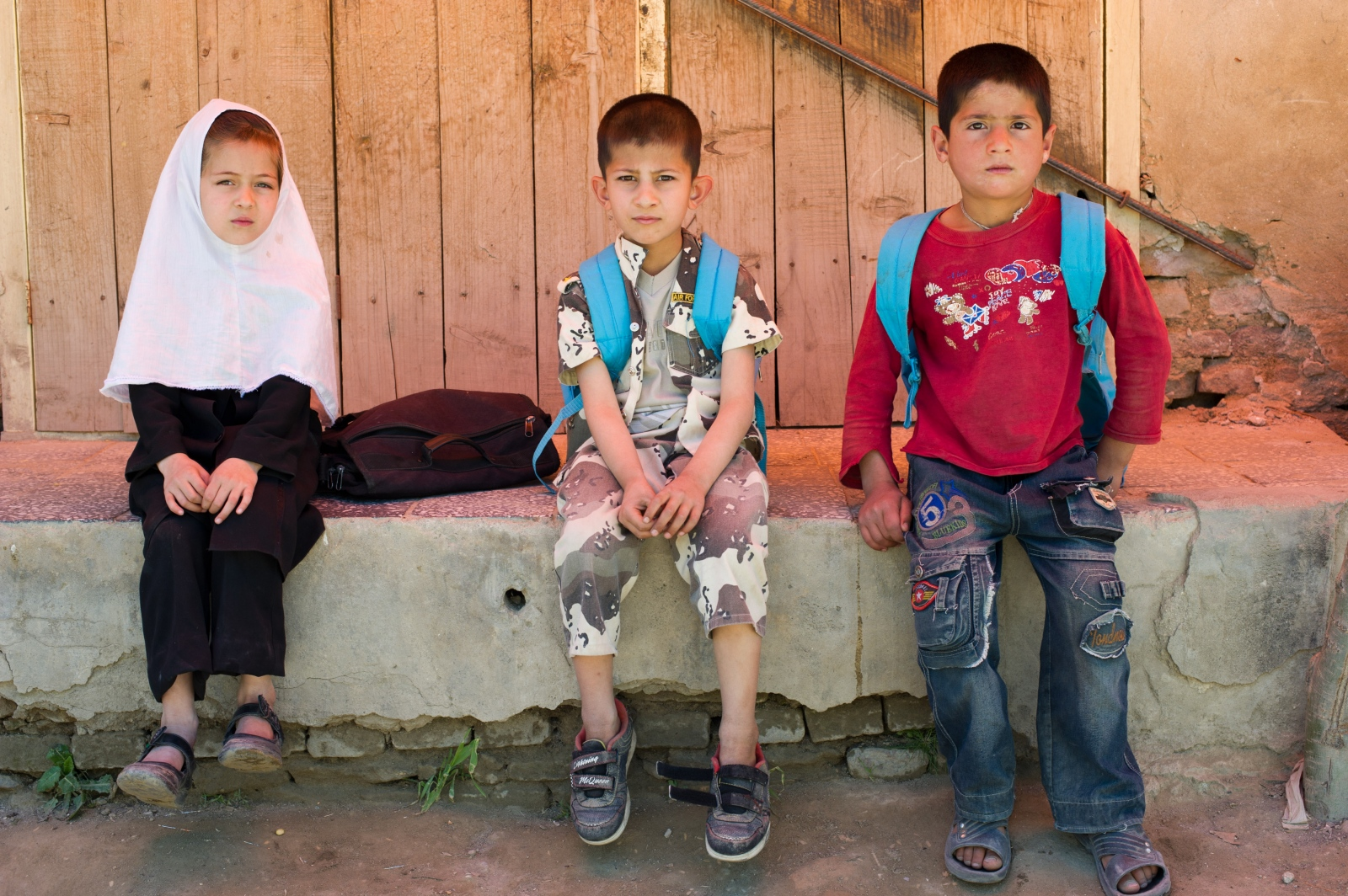 Afghan children wait for school in Istalif, Afghanistan.