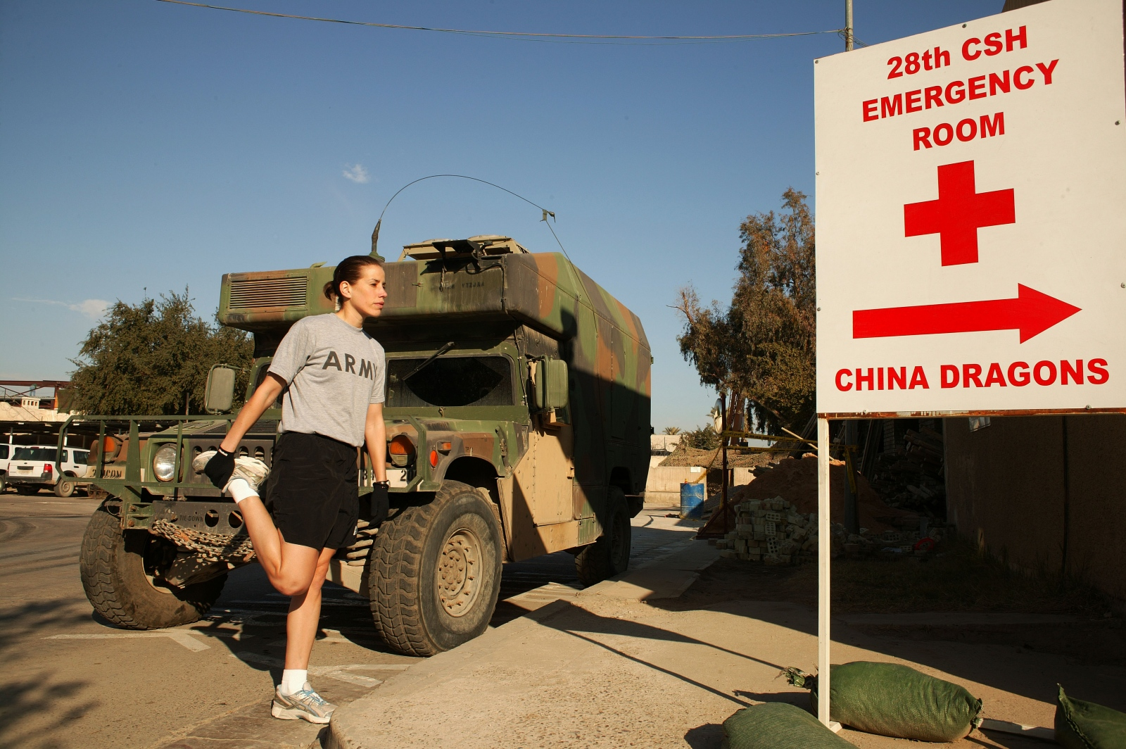 CPT Kara Weigel, a physical therapist with the Baghdad Combat Area Support Hospital stretches before a run in Baghdad's Green Zone.
