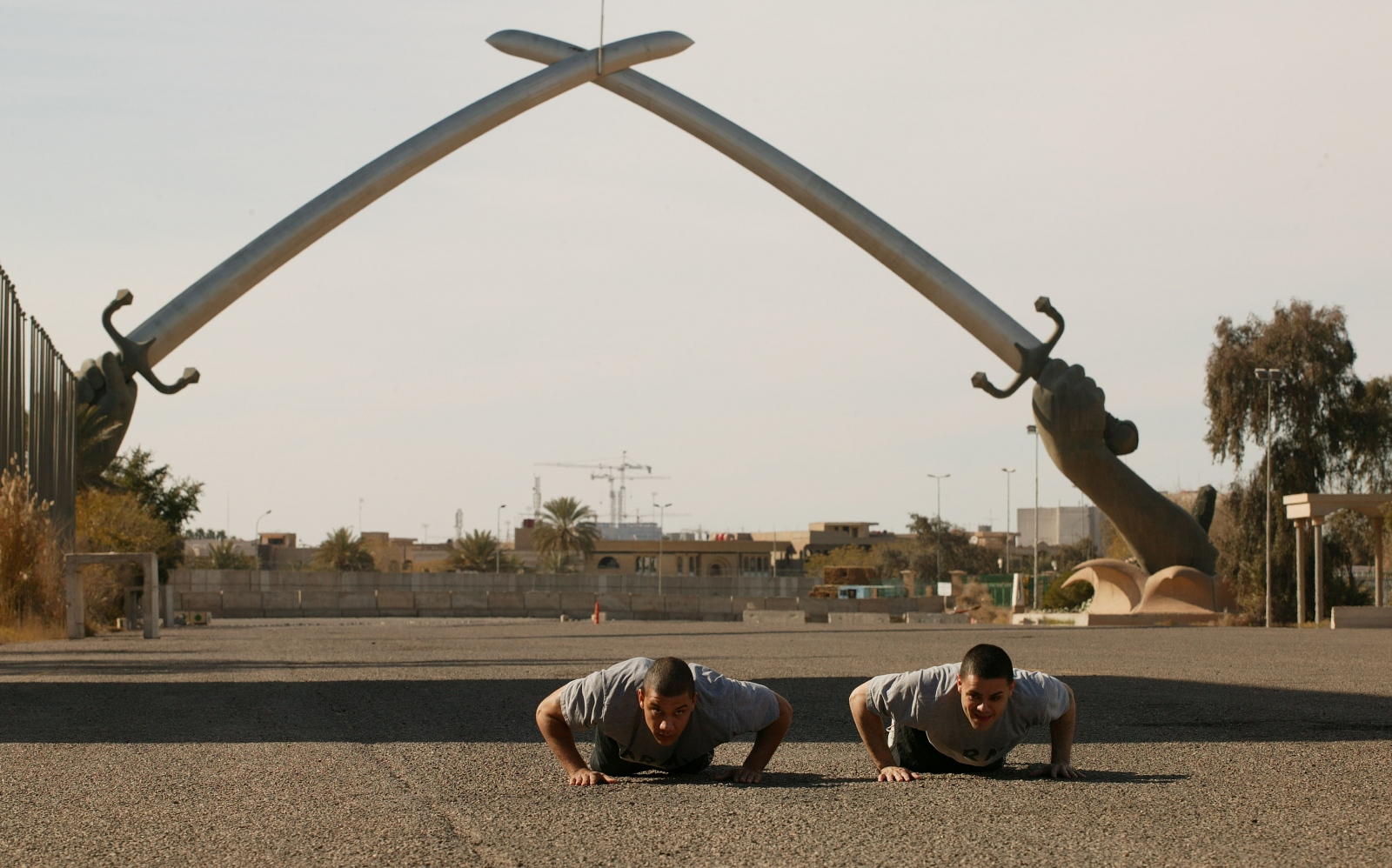U.S. soldiers work out under the Swords of Qādisīyah in Baghdad.