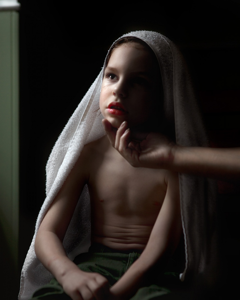 "Santified Morning Rituals, 2015 Archival Pigment Print 20"" x 24"" We were getting ready for school. I had taken Thomas a shower and he liked me to wrap the towel on his head like I did when my hair was wet. Suddenly the towel unmingled itself and fell in this form. The light shun so beautifully on him"