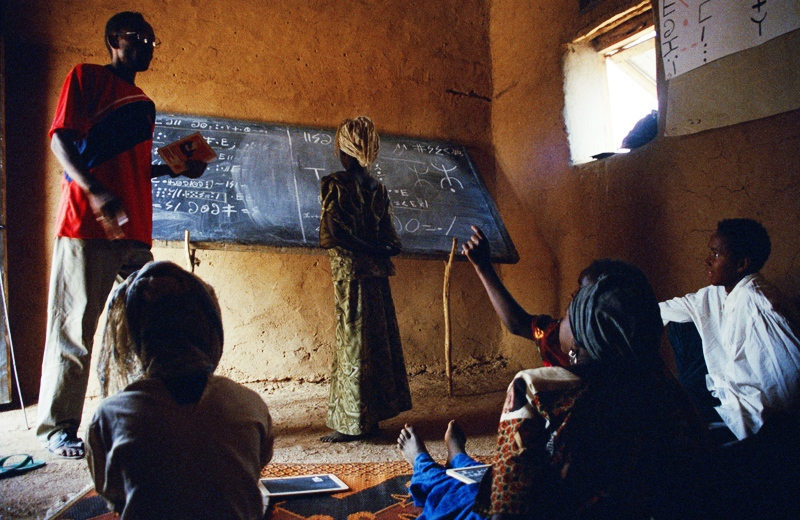 Sidi Moumounta, a Tuareg journalist and cultural activist, teaches Tifinagh to Tuareg children in his hometown of Iferouane. Iferouane, Niger 2005