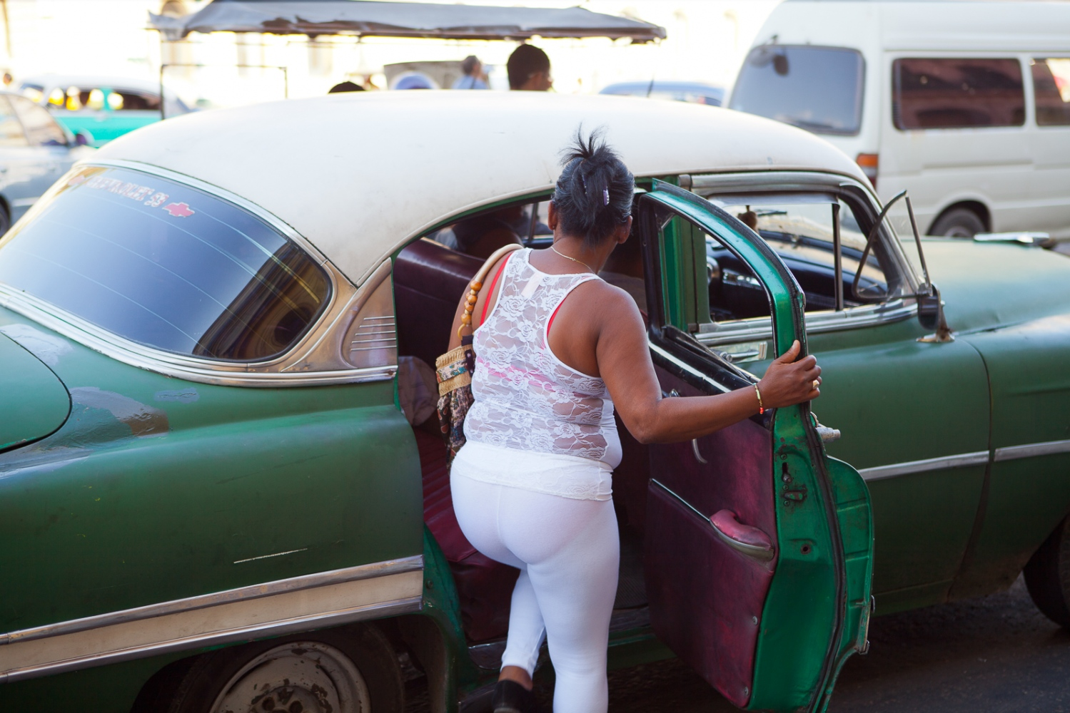 Street scene, Havana. Cuban women have no qualms or concerns about whether they are fat, skinny, or in between. They love to wear body-con outfits.