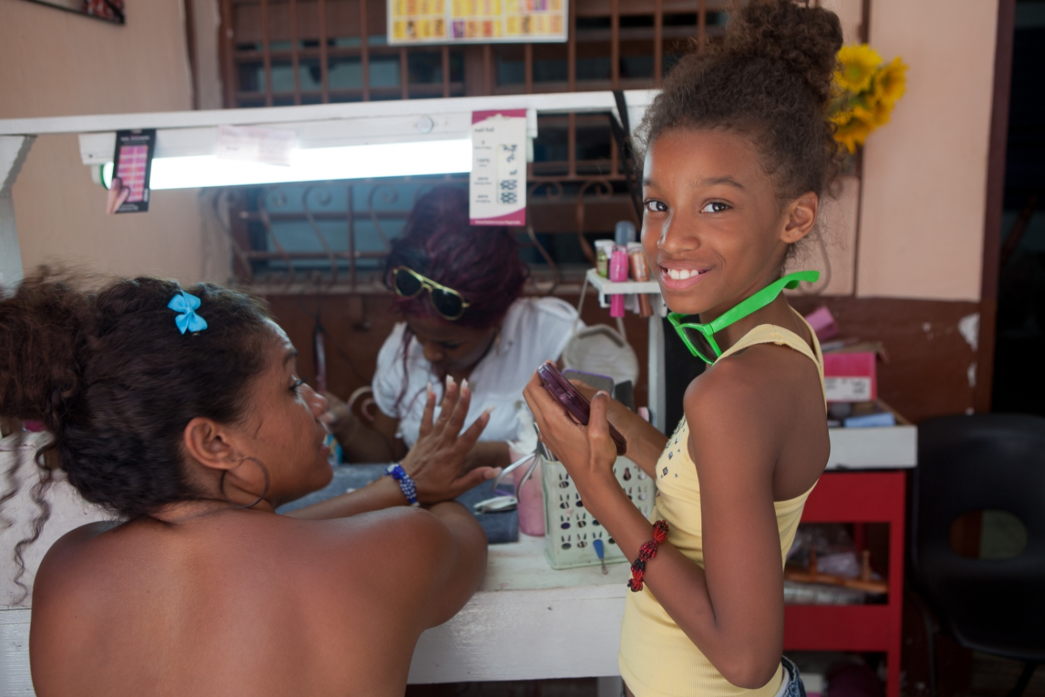 Mother and daughter at a street-side nail salon in Havana. Small, regulated private businesses had started to appear with a slight loosening of central planning when I visited in 2013.