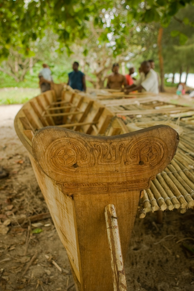Traditional carving of canoe prows is still valued. In this village in the Louisiade Archipelago, men gathered in community to build and craft this vessel.
