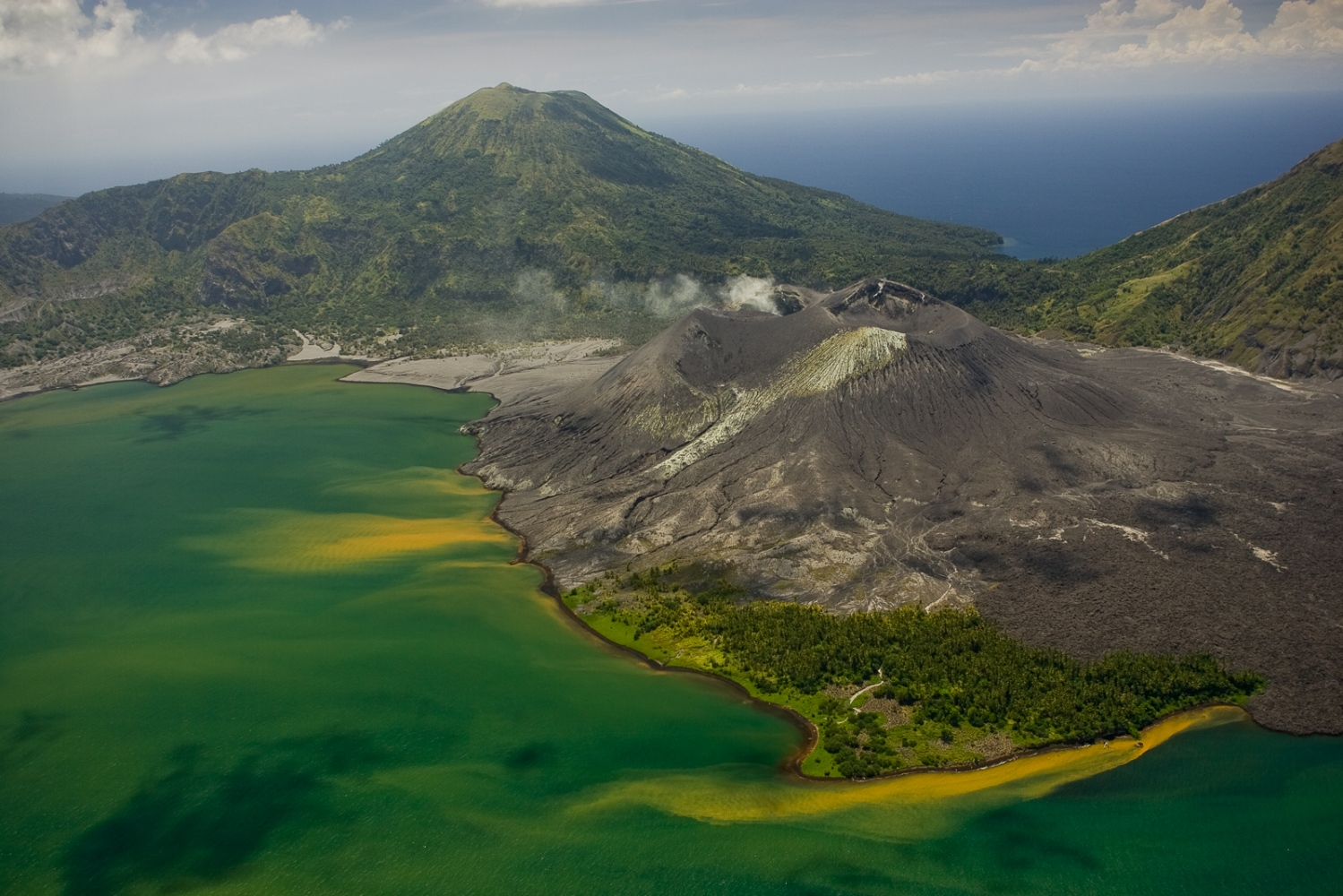 Still active Tavurvur volcano in New Britain. Tavurvur erupted with a vengeance in 1994, wiping out the nearby town of Rabaul.