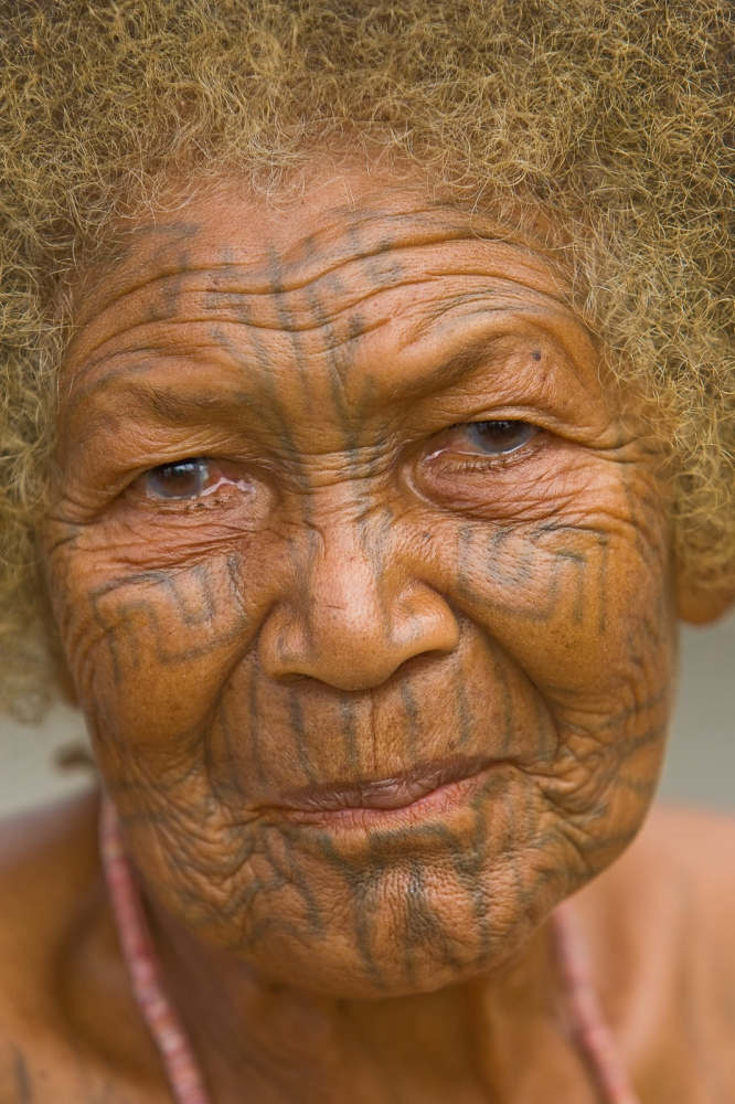 One of the last surviving women with full body tattooing. Along the southeast coast, Papua New Guinea.