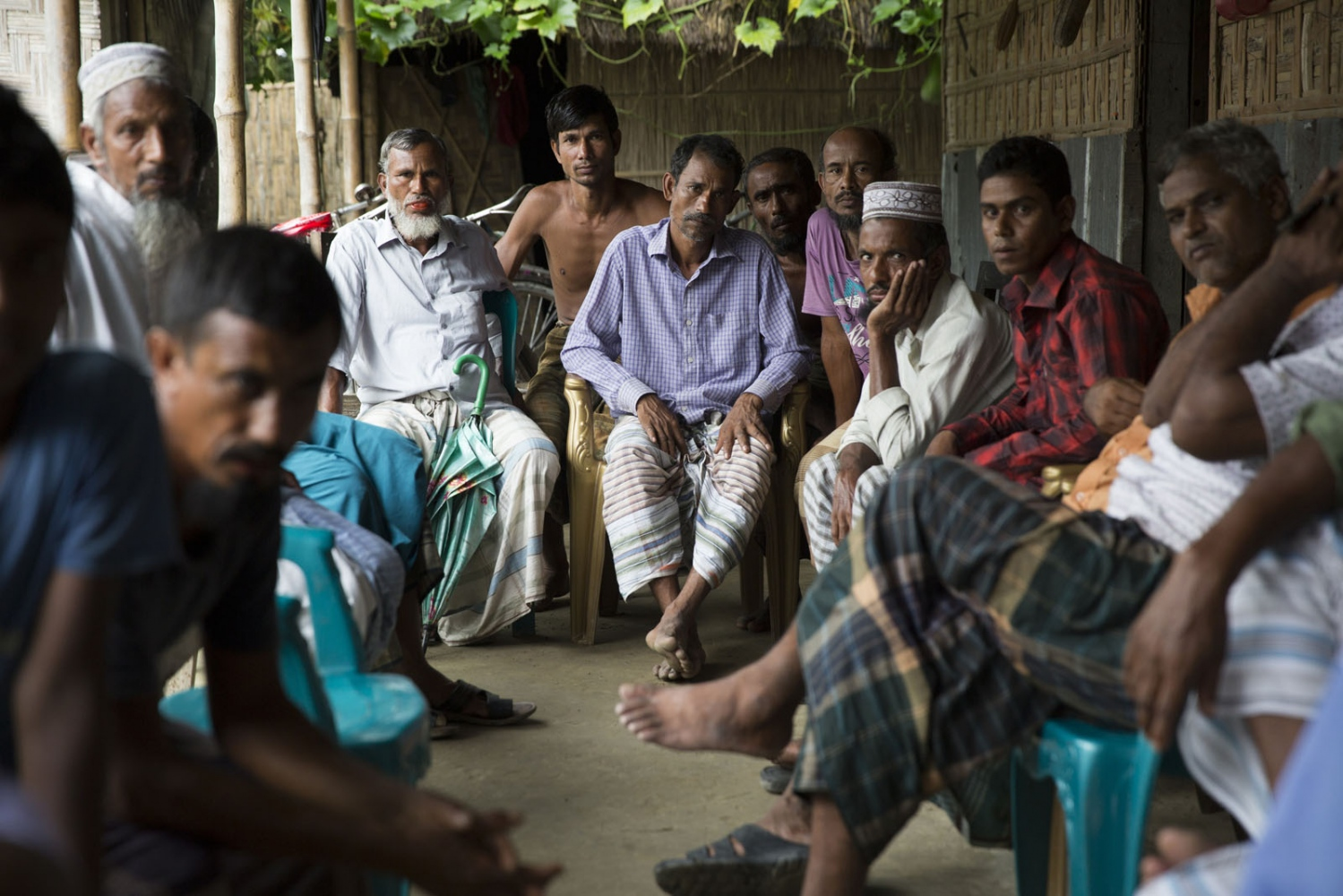 At Borezerdanga village in one of the enclaves near the town of Debiganj a meeting is being held between village elders and men known as 'peace keepers'. Here to discuss the issue of an underage marriage, until a few weeks ago when the enclaves were disbanded the Bangladeshi police had no jurisdiction inside the enclaves so residents relied on peace keepers to sort out problems ranging from illegal logging to land disputes.
