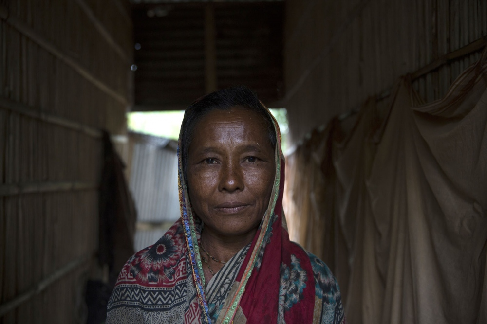 A lady from Ponchoki Bhajini village located inside the enclave of Dhoholakhagrabari. In a few months she will leave for India to start a new life as an Indian citizen.