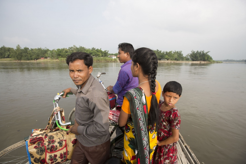 A boat is used for locals wanting to cross the Teesta River where enclaves dots both sides of its banks. Even for the land outside the enclaves this region is very underdeveloped.