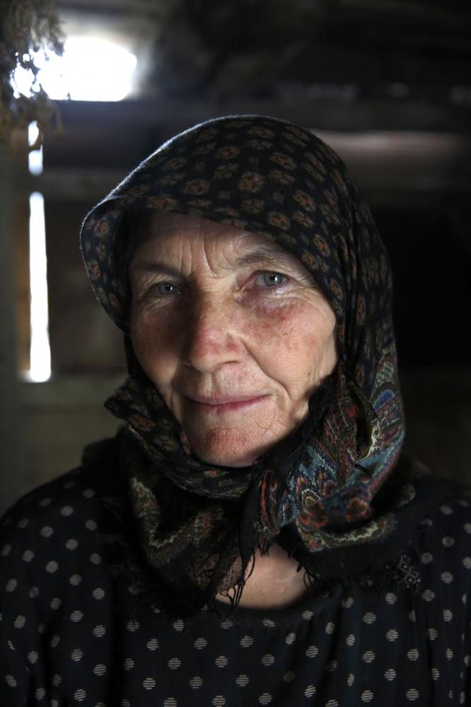 A portrait of an old lady in Kvankhidatli village.