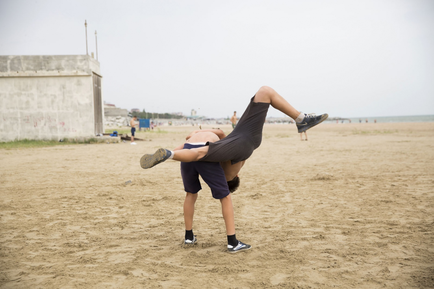 Young buys are taught wrestling on a beach by the Caspian Sea. Fighting is embedded in to the culture of Dagestan and it is renowned around the world for producing large numbers of great fighters from wrestlers to mixed martial arts. The Russian government in Moscow also sends large amounts of funding to help train such fighters.