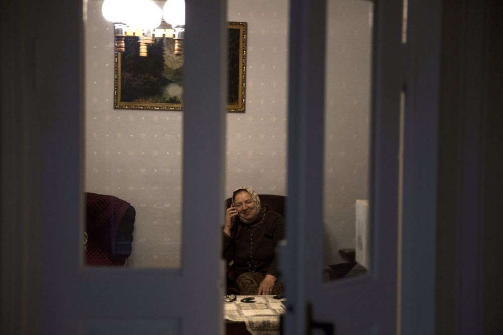 Dagestan native Patipat Gadzhidadaev talks to her friend on the phone in her house.