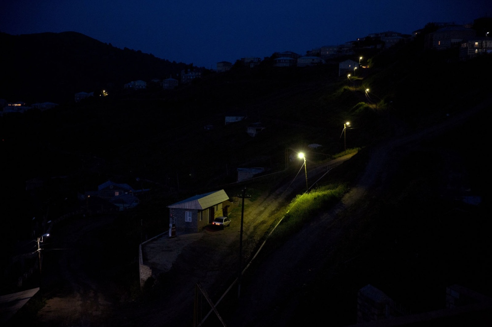 Street lamps illuminate the only road leading through the village of Kubachi. The village inhabited by people of the Dargin ethnic group is famous throughout the whole of Russia for its skilled silver craftsmen who are commissioned from across Russia and abroad.