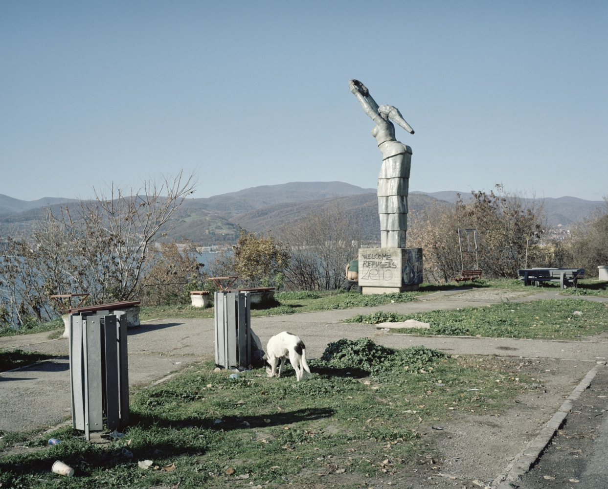 Romania, Orsova. A communist style monument with a wrote welcoming refugees.