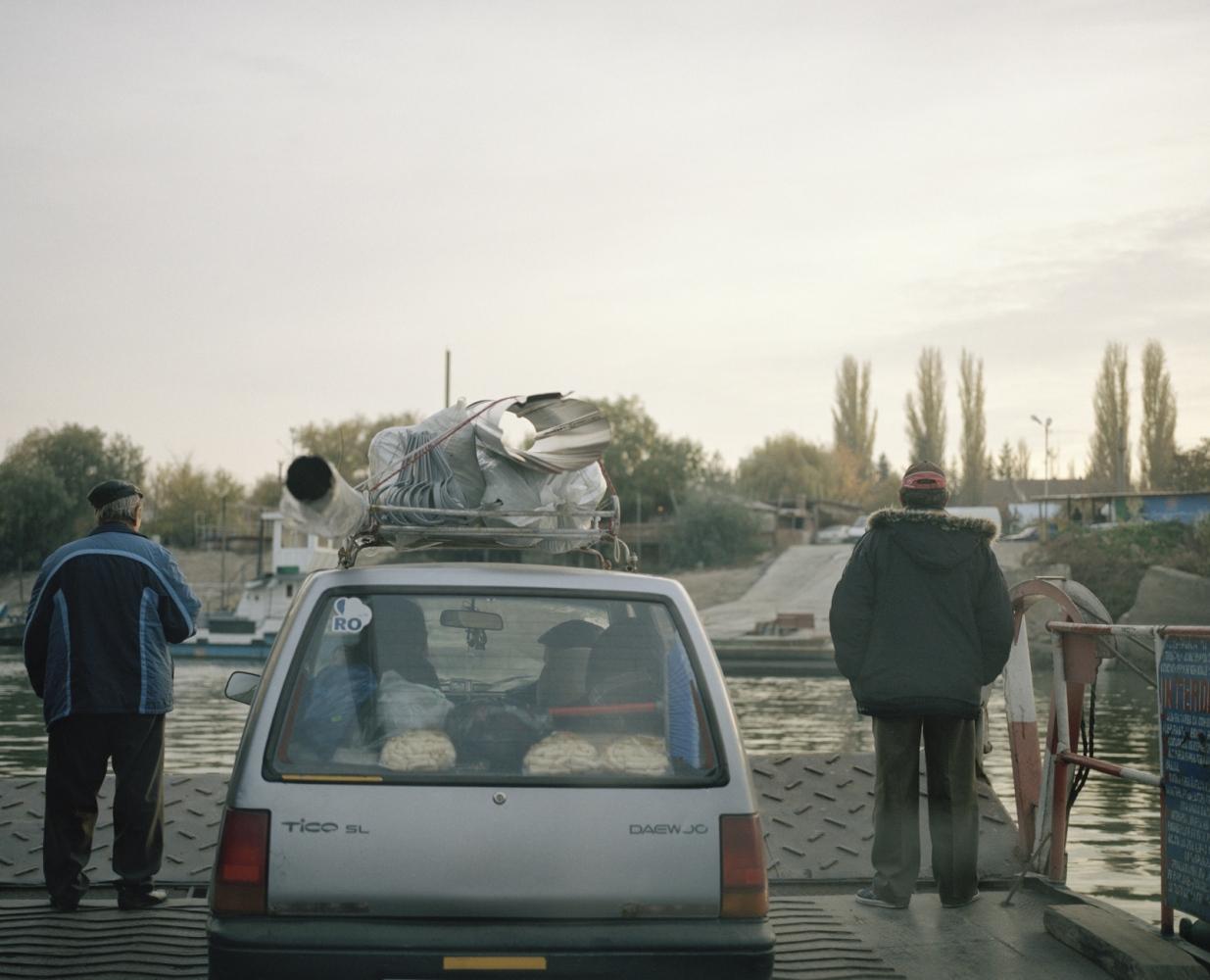 Romania, Calarasi. A Romanian family cross the Danube in a ferry.