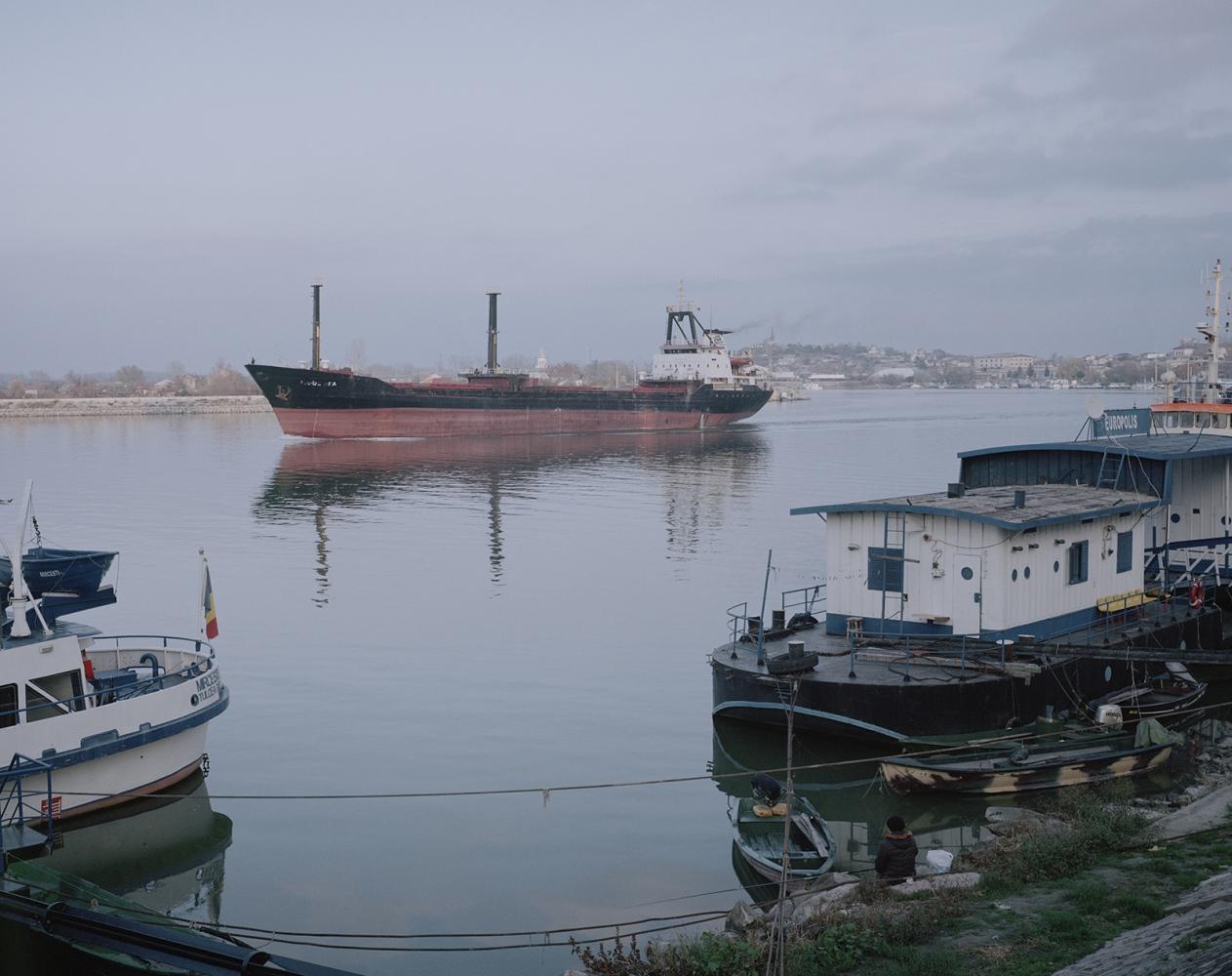 Romania, Tulcea. a cargo boat enter in the port of Tulcea.