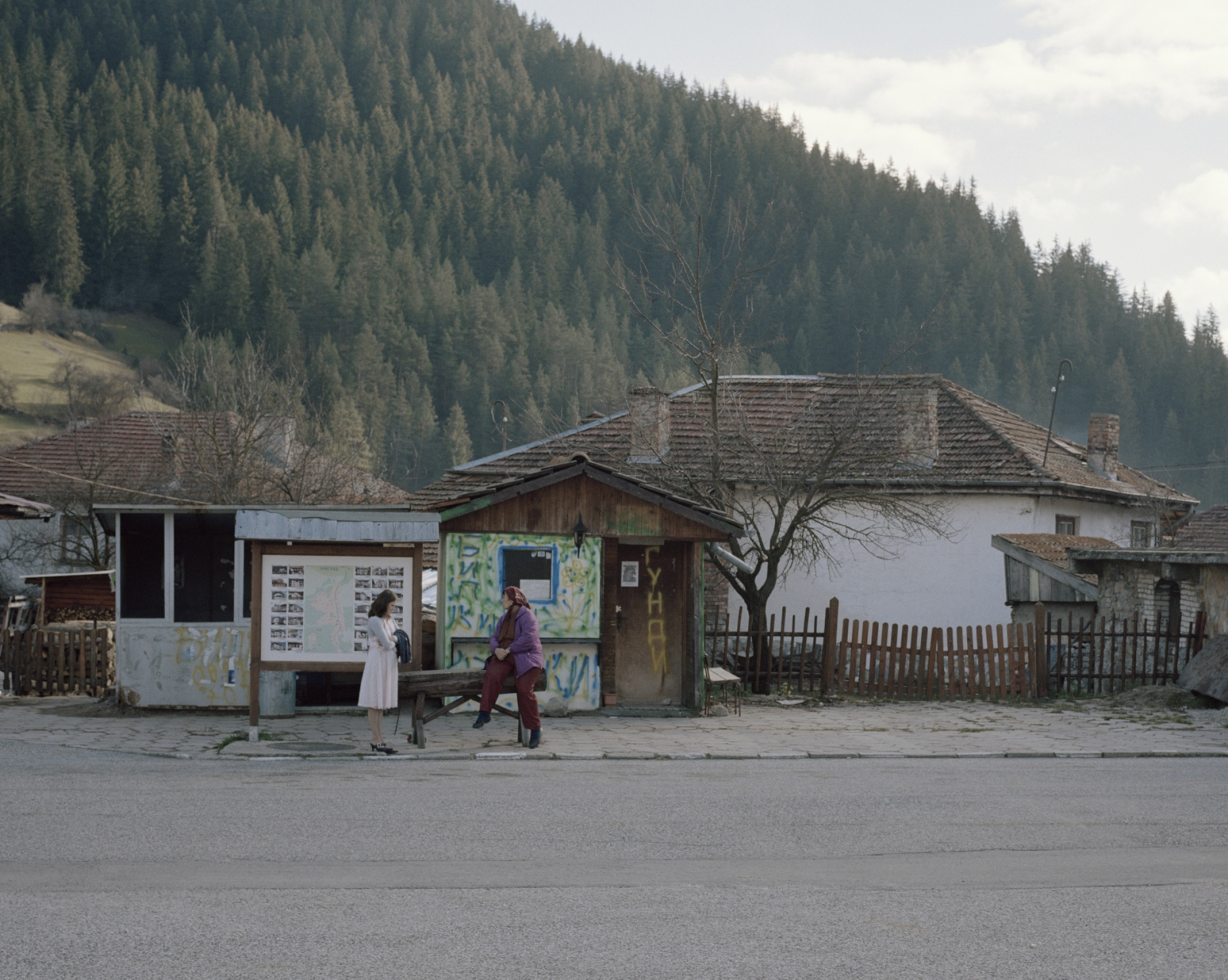 Bulgaria, Trigrad. Two women stand on the side of the road.