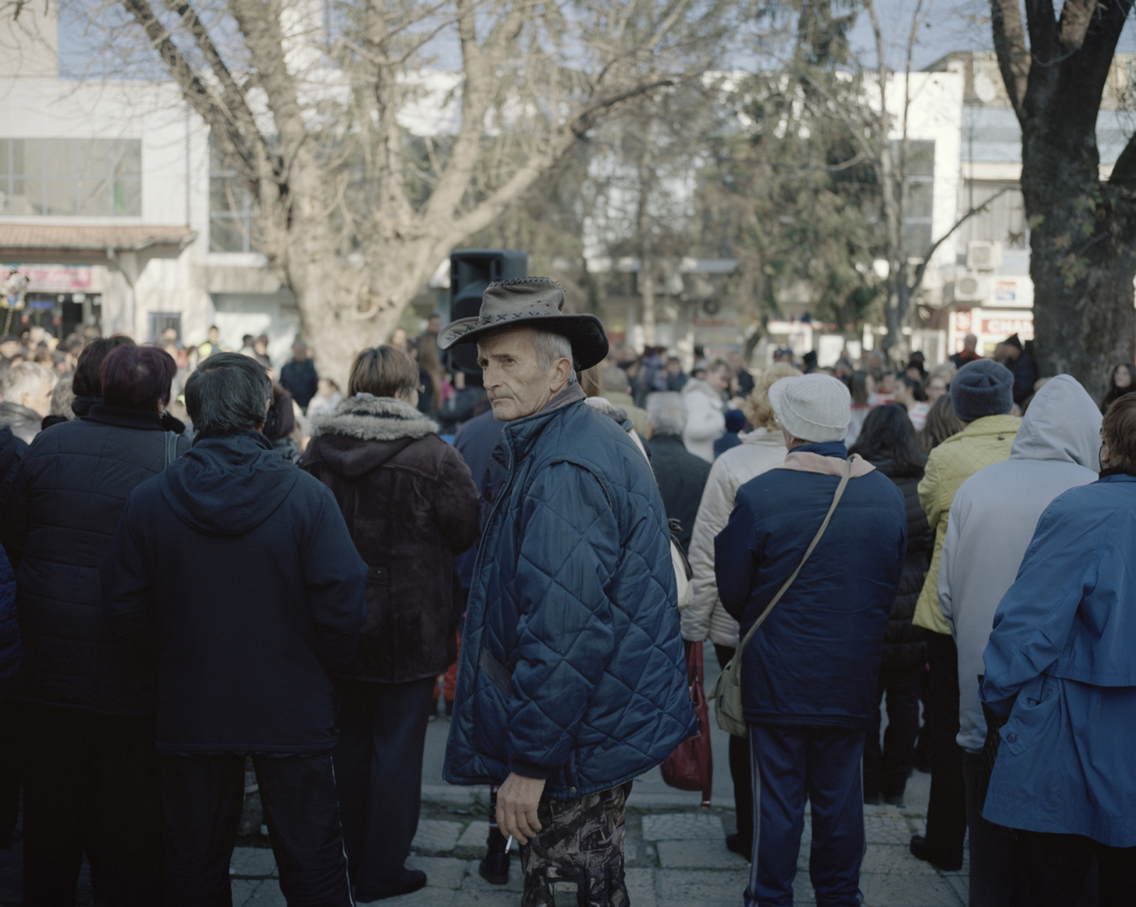 Bulgaria, Svilengrad. A man watching Christmas celebration on the road.