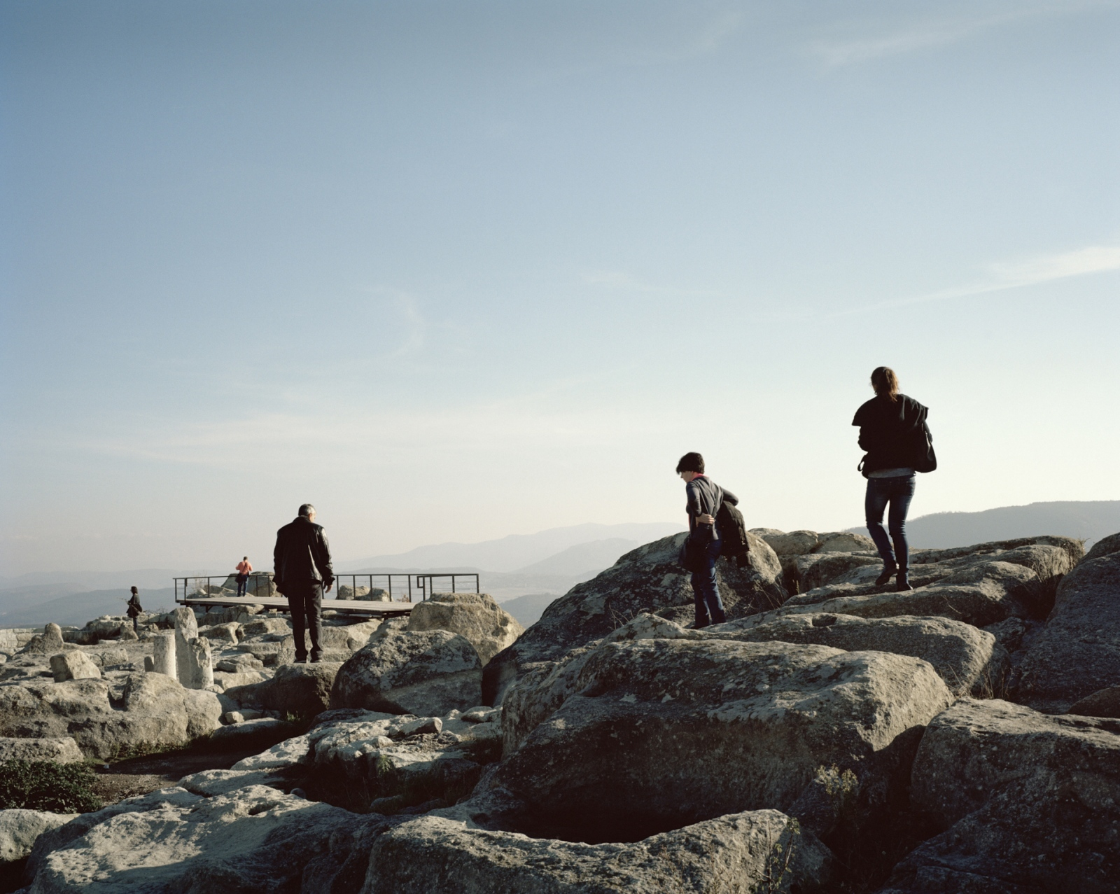 Bulgaria, Perperikon. Tourists visit the remains of the temple from where Alexander the Great decided to built his Empire.